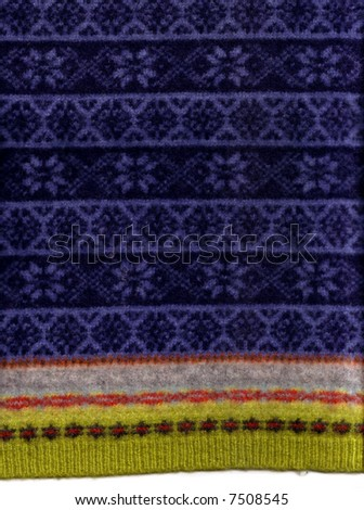 A thick felted knit sweater with snowflake patterns, suitable for use as a background texture. - stock photo