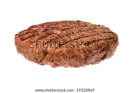 A thick, juicy hamburger patty cooked on a barbecue isolated on white. - stock photo