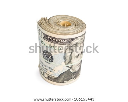 A thick stack of twenties rolled and secured with a rubber band. - stock photo