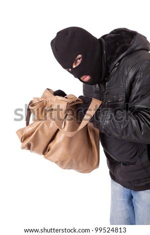 A Thief, stealing a purse - stock photo