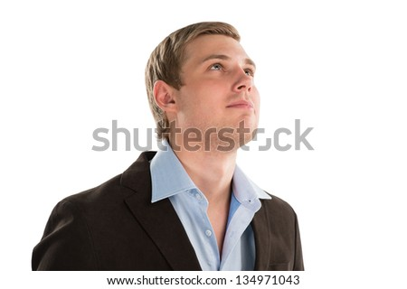 A thoughtful businessman looking up towards copyspace while isolated on white - stock photo