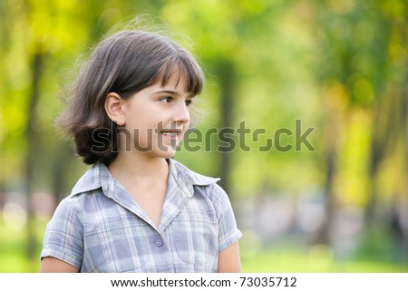 A thoughtful girl is walking in the autumn park - stock photo