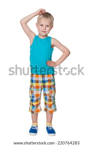 A thoughtful little boy stands against the white background and thinks - stock photo