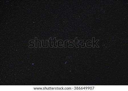A three minute long exposure of the Orion constellation showing millions of stars as well as other Messier objects - stock photo