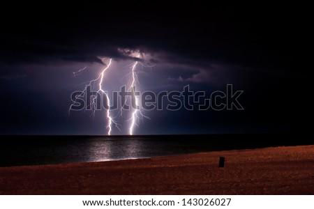 A thunderstorm approaching the Lake Michigan lakeshore. - stock photo