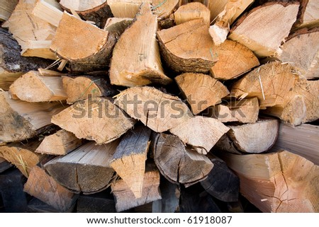 A tight stack of already cut and dried firewood. - stock photo