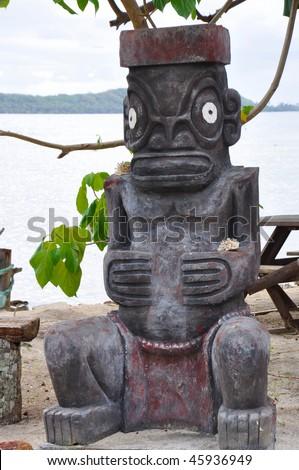 A Tiki fertility god statue in Tahiti. - stock photo
