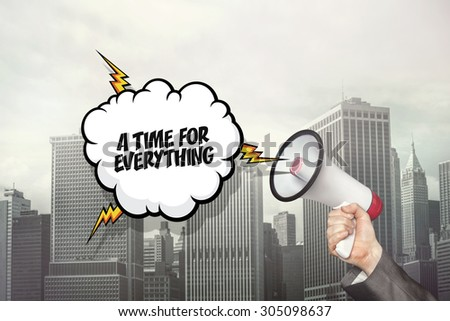 A time for everything text on speech bubble and businessman hand holding megaphone on cityscape background - stock photo