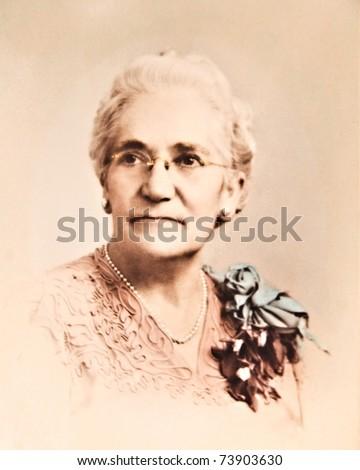 A tinted sepia photo of a grandmother circa 1940's. - stock photo