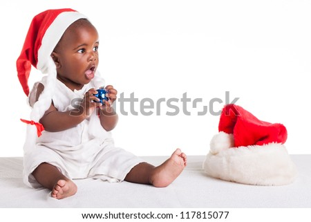 A tiny African baby girl are ready for her first Christmas to arrive. - stock photo