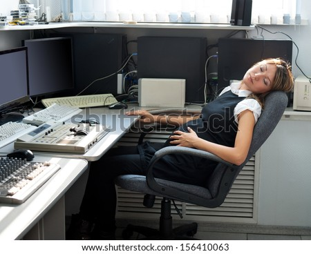 a tired young pregnant woman audio producer rests at work - stock photo
