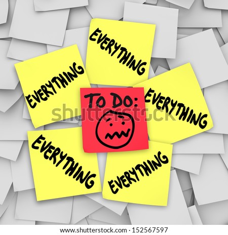 A to-do list on sticky notes with the word everything to illustrate how overwhelming the amount of tasks have you feeling - stock photo