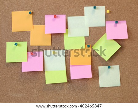 A To Do List with colorful post it papers on cork notice board  - stock photo