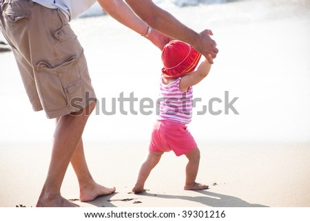 A toddler is a young child who is of the age of learning to walk - stock photo