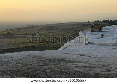 A tomb at the Hierapolis engulfed by the sediment from the hot springs of Pamukkale, Turkey. - stock photo