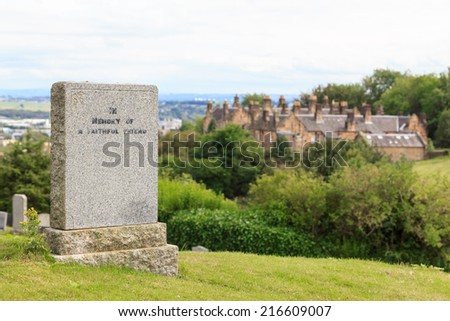 A tombstone in memory of a faithful friend on a hill in Stirling, Scotland - stock photo