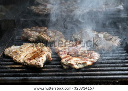 A top sirloin steak flame broiled on a barbecue, shallow depth of field. - stock photo