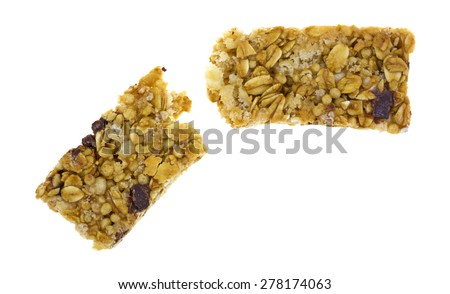 A top view of a broken granola bar on a white background. - stock photo