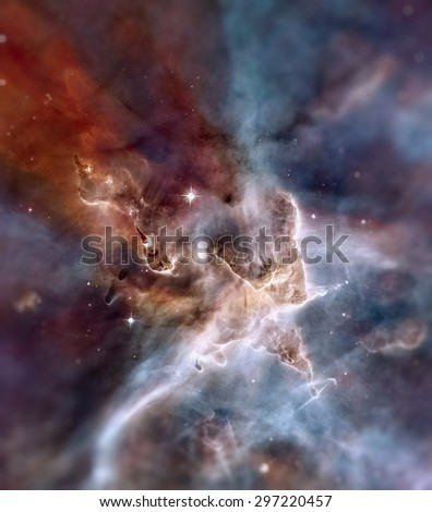 "A towering ""mountain"" of cold hydrogen gas laced with dust is the site of new star formation in the Carina Nebula. Space with stars, nebula and galaxy. Elements of this image furnished by NASA. - stock photo"