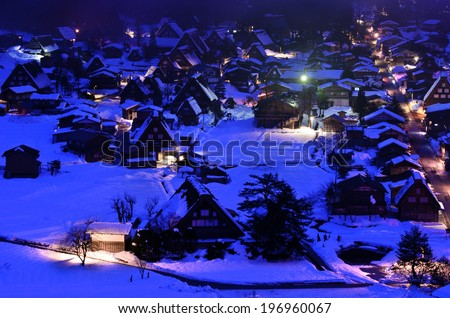 A town with a lot of houses in the snow. - stock photo