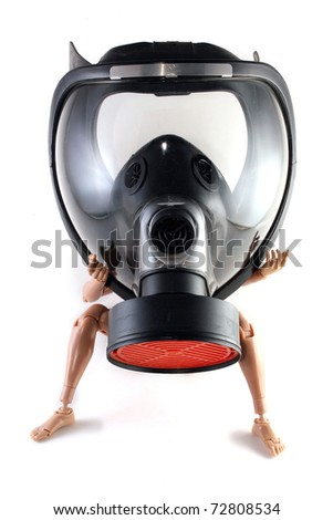 A toy figure wearing a black gas mask - stock photo