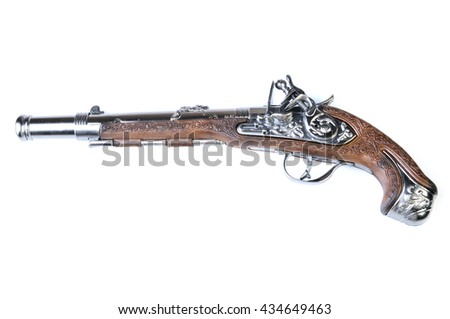 a toy gun (revolver) isolated on a white background - stock photo