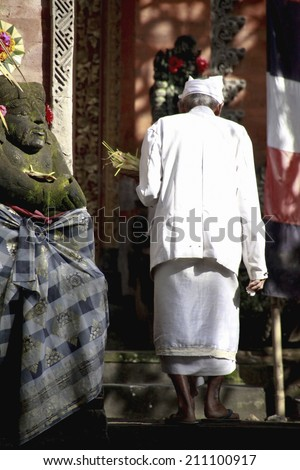 A Traditional Bali-Style Decoration And An Old Person - stock photo