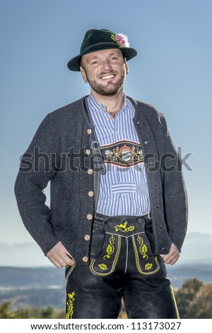 A traditional bavarian man in the autumn nature - stock photo