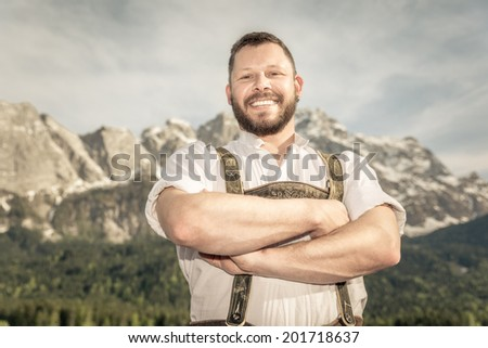 A traditional bavarian man in the nature - stock photo