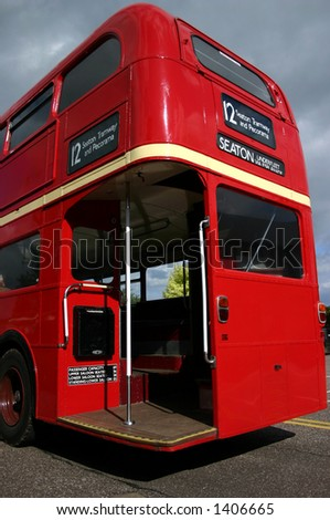 A traditional bright red double decker Routemaster London bus - stock photo