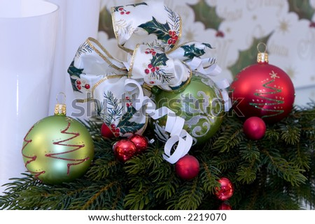 A traditional christmas decoration, christmas ball with christmas bow tied to it, pine branch, copy space - stock photo