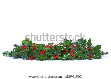A traditional Christmas garland made from fresh holly with red berries, green ivy leaves and sprigs of conifer spruce. Isolated on a white background. - stock photo