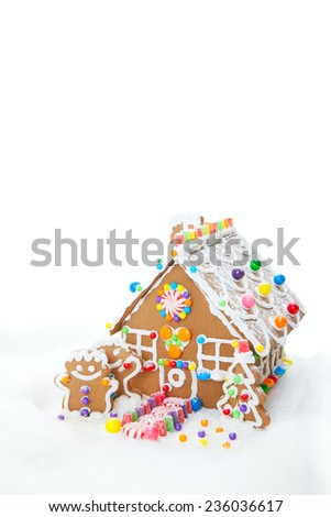 A traditional Christmas treat, gingerbread house with gingerbread people. - stock photo
