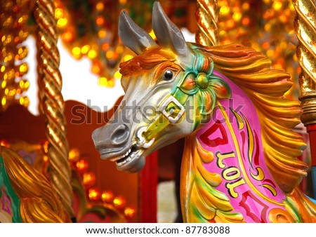 A Traditional Horse on a Fun Fair Carousel Ride. - stock photo