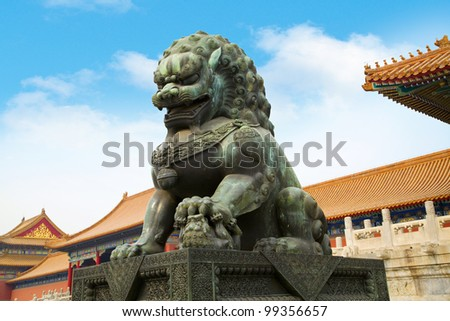 A traditional Imperial guardian lion at the Gate of Supreme Harmony in Forbidden City. Beijing, China. - stock photo