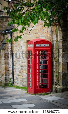 A traditional red Phone Box in England - stock photo