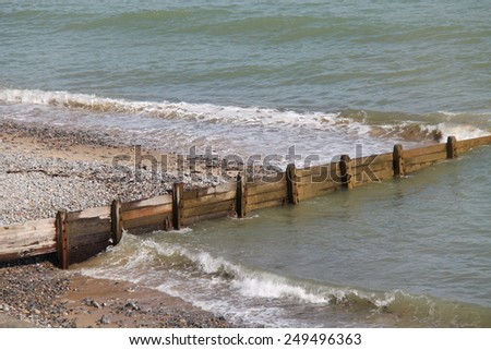 A Traditional Wooden Beach Defence Against Erosion. - stock photo