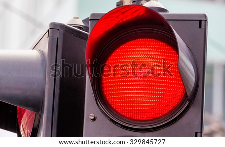 a traffic light shows red light. symbolic photo for grip end. - stock photo