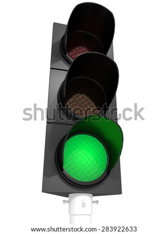 A traffic light with an active green light - stock photo