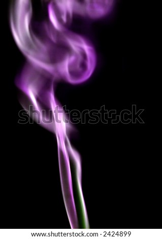 A trail of purple and green tinged smoke, with black background. - stock photo