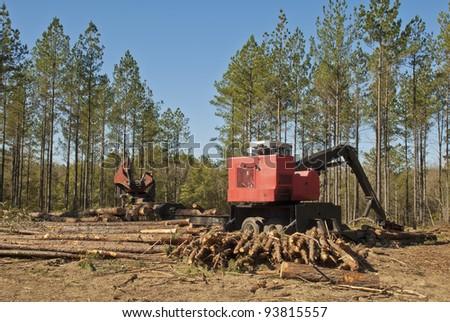 A trailer mounted log loader. - stock photo