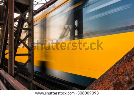 A train passes by at a steel bridge - stock photo