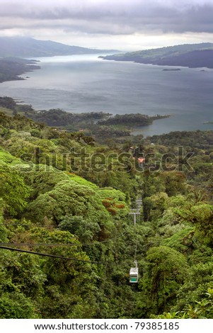 A tram takes visitors through a jungle near Lake Arenal, Costa Rica - stock photo
