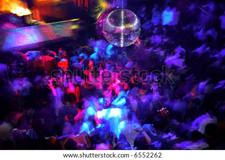 A trance party in a crowded club - stock photo