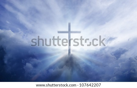 A transparent Cross giving out heavenly light in the sky. - stock photo