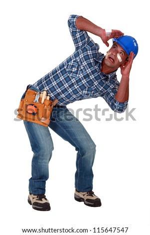 A traumatized tradesman - stock photo
