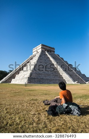 A traveler with view of Chichen Itza in Mexico - stock photo