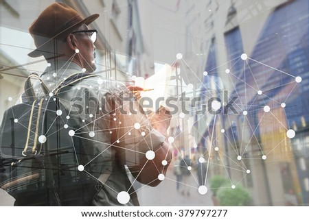A traveling man concentrate and appreciate in urban touring. Image can use for tourism and traveling. - stock photo