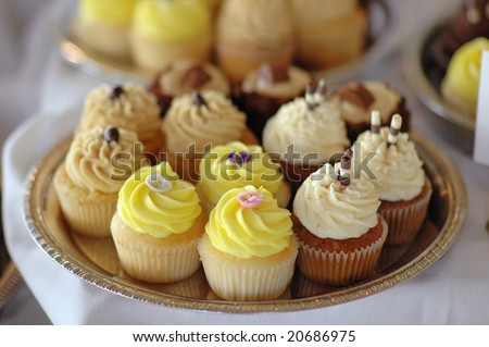 A tray of cupcakes at a wedding reception. - stock photo