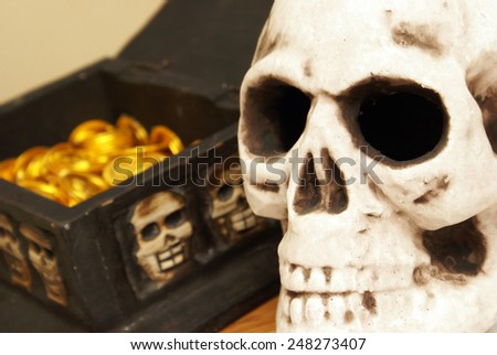 A treasure chest has been opened to reveal its abundant gold coins within. - stock photo